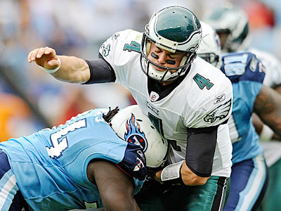 Eagles quarterback Kevin Kolb is hit by Titans defensive tackle Sen´Derrick Marks. (Clem Murray/Staff Photographer)