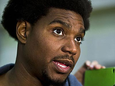 Sixers center Andrew Bynum admitted that bowling may have caused the injury to his left knee. (Matt Rourke/AP)