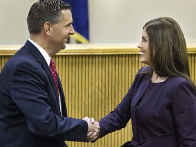 Republican David Freed, left, and Democrat Kathleen Kane, shake hands after a televised debate for the state attorney general´s office Monday, Oct. 22, 2012, at Widener University School of Law in Harrisburg, Pa. Elections are Nov. 6. (AP Photo/The Patriot-News, Dan Gleiter)