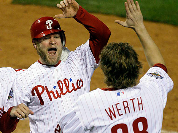 Philadelphia Phillies´ Eric Bruntlett, center, celebrates with Jayson Werth (28) and Matt Stairs after Bruntlett scored the winning run to beat the Tampa Bay Rays 5-4 in Game 3 of the baseball World Series in Philadelphia, Saturday, Oct. 25, 2008. (AP Photo/Julie Jacobson)