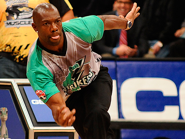 In this photo taken on Jan. 27, 2013, and provided by the Professional Bowlers Association, former NFL football player Terrell  Owens bowls during the PBA Detroit Winter Swing. (AP Photo/PBA, Tim Fuller)
