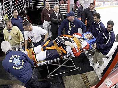Florida Panthers forward David Booth is wheeled off the ice after being injured in the second period against the Flyers. (AP Photo/Matt Slocum)