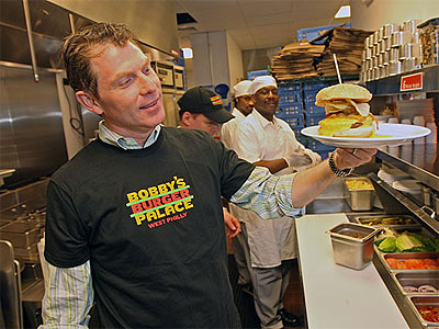 The Food Network´s Bobby Flay shows off his Philly Hamburger, with Cheese Whiz, potato chips under the bun. His Bobby´s Burger Palace opens Tuesday at 3925 Walnut St. in University City, serving Angus burgers, shakes, fries. (MICHAEL BRYANT / Staff Photographer)