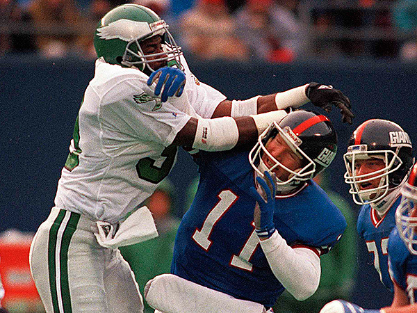 New York Giants quarterback Phil Simms is hit by Philadelphia Eagles William Frizzell during the 1989 season. (AP Photo/Ray Stubblebine)