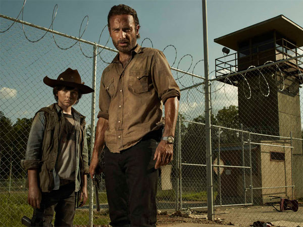 "Chandler Riggs (left) plays Charles Grimes, and Andrew Lincoln plays his father, Rick, in ""The Walking Dead."" (Frank Ockenfels / AMC)"