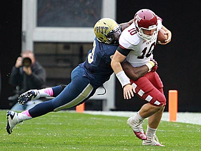 Temple quarterback Chris Coyer is sacked in the first half by Pitt´s Todd Thomas. (David Swanson/Staff Photographer)