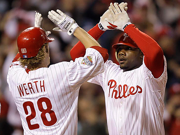 Philadelphia Phillies´ Ryan Howard, right, is congratulated by Jayson Werth after hitting a three run home run during the fourth inning of Game 4 of the 2008 World Series.