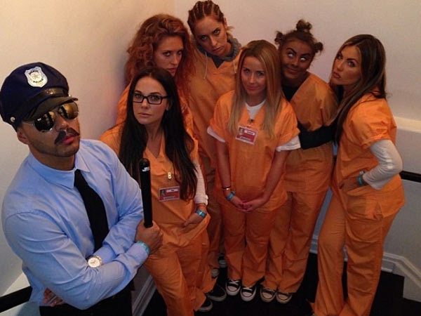 "Julianne Hough (second from right) wears blackface as part of her ""Crazy Eyes"" Halloween costume. (Photo via Instagram)"