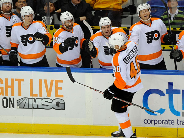 Vincent Lecavalier (40) celebrates his goal against the New York Islanders with teammates in the first period of an NHL hockey game at the Nassau Coliseum on Saturday, Oct. 26, 2013, in Uniondale, N.Y. Lecavalier scored three goals during the Flyers 5-2 win. (Kathy Kmonicek/AP)