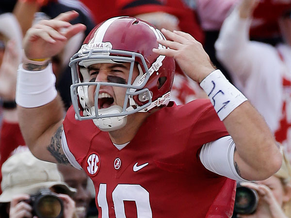 Alabama quarterback AJ McCarron (10) celebrates after a first half score against Tennessee in an NCAA college football game in Tuscaloosa, Ala., Saturday, Oct. 26, 2013. (Dave Martin/AP)