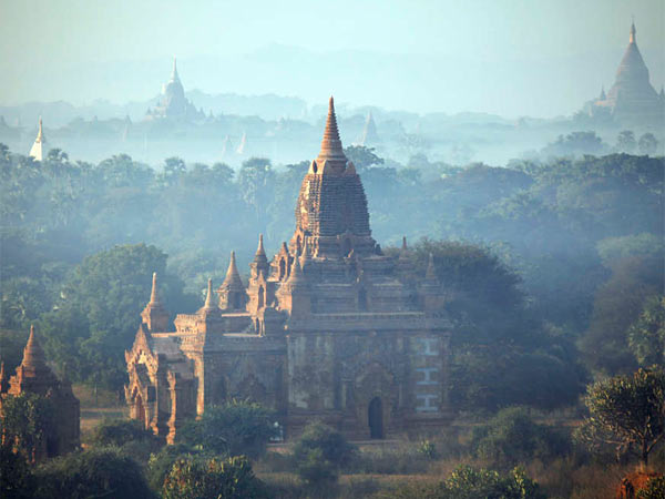 Ancient temples at sunrise, Bagan, central Myanmar. After half a century, the country now invites all to come discover its palaces, legends, mysteries.
