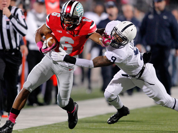 Ohio State defensive wide receiver Evan Spencer, left, is tackled by Penn State corner back Jordan Lucas during the second quarter of an NCAA college football game Saturday, Oct. 26, 2013, in Columbus, Ohio. (Paul Vernon/AP)