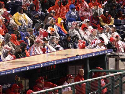 Fans dressed in rain gear watch Game 5 of the World Series in a driving rain at Citizens Bank Park. The game was delayed in the sixth inning. (Steve Falk / Staff Photographer)