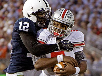 Penn State cornerback Stephon Morris tackles Ohio State quarterback Braxton Miller in the first half. (Gene J. Puskar/AP)
