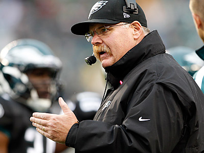 Andy Reid yells from the sidelines during the second quarter against the Falcons. (Yong Kim/Staff Photographer)