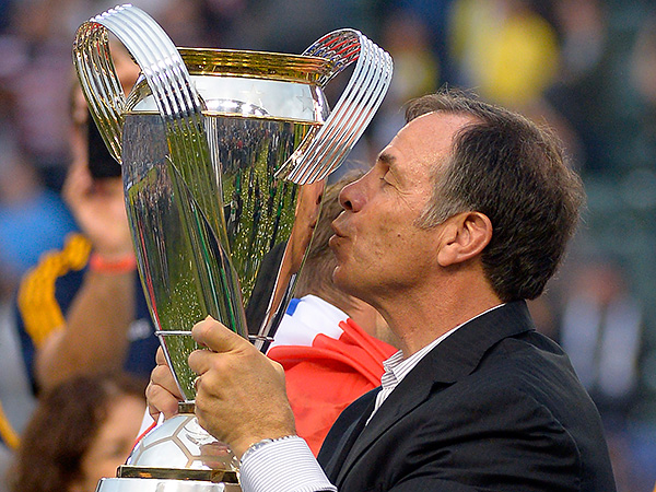Los Angeles coach Bruce Arena kisses the MLS Cup trophy after the Galaxy won their second consecutive title last year. (Mark J. Terrill/AP file photo)