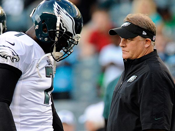 Philadelphia Eagles head coach Chip Kelly walks past Michael Vick during a preseason NFL football game against the Carolina Panthers on Thursday, Aug. 15, 2013, in Philadelphia. (AP Photo/Michael Perez)