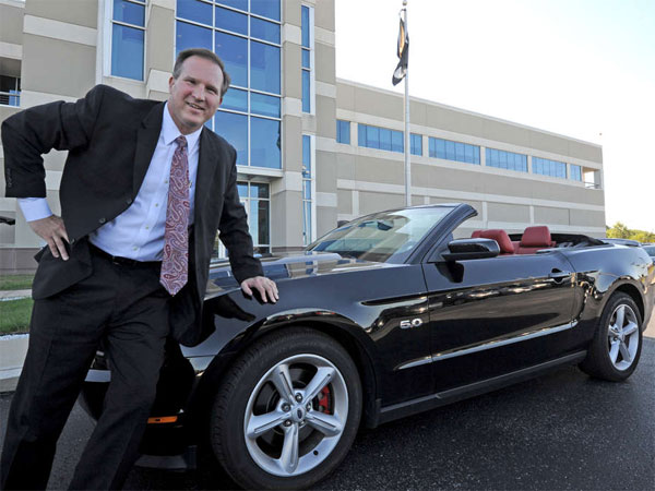 "Kevin Cramton, CEO of Cardone Industries, the city´s largest manufacturer, with his ""baby."" (April Saul / Staff Photographer)"