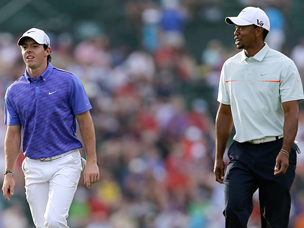 Rory McIlroy and Tiger Woods. (Darron Cummings/AP)