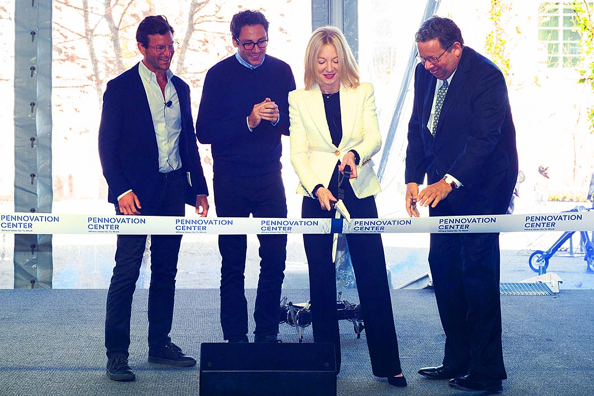 Ribbon Cutting at Pennovation Center. Left to right: David Gilboa and Neil Blumental, co-founders and co-CEOs of Warby Parker, Penn President Amy Gutmann and David L. Cohen, chair of Penn's Board of Trustees.