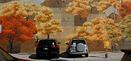 "Cars parked in front of the ""Autumn"" mural."