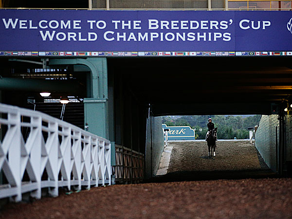 A jockey leaves the track after a morning training session at Santa Anita Park. (Jae C. Hong/AP)