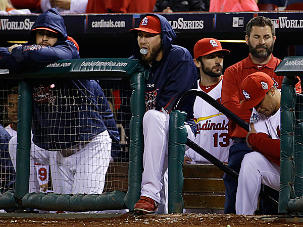 Cardinals players watch the ninth inning of Game 5 against the Red Sox. (Matt Slocum/AP)