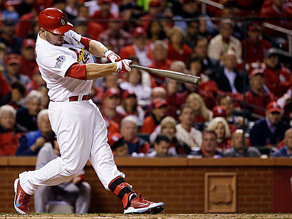 The Cardinals´ Matt Holliday hits a home run during the fourth inning of Game 5. (Jeff Roberson/AP)