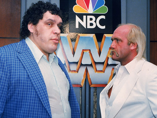 "World Wrestling Federation Heavyweight Champion Hulk Hogan, right, faces off against Andre the Giant at a New York press conference on Feb. 3, 1988 to promote their upcoming bout on ""The Main Event,"" an NBC prime time special to be aired Feb. 5th. (Richard Drew/AP file)"