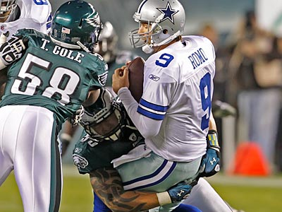 Jason Babin sacks Tony Romo in the first quarter as Trent Cole provides added pressure. (Ron Cortes/Staff Photographer)