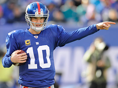 Eli Manning and the Giants improved to 5-2 with a win over the Dolphins. (Bill Kostroun/AP)