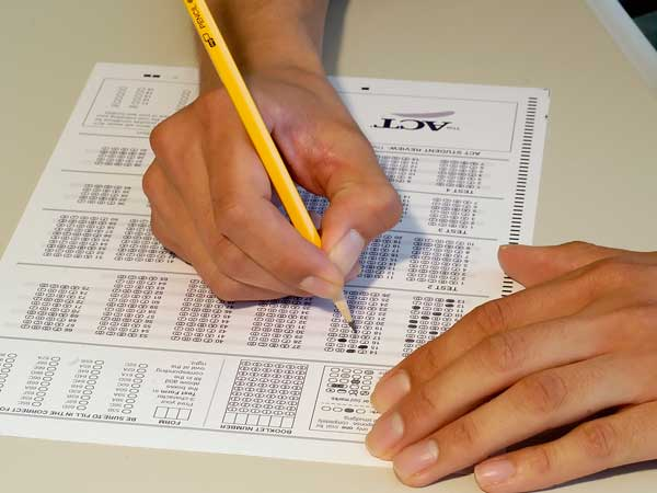 A student fills in an answer sheet for a standardized test. (Photo courtesy of ACT)
