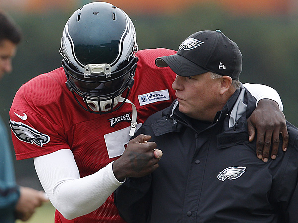 Eagles quarterback Michael Vick and head coach Chip Kelly during practice at the NovaCare Complex on October 30, 2012. (David Maialetti/Staff Photographer)