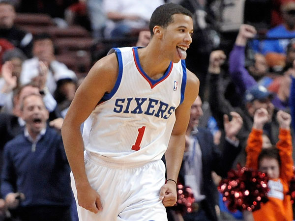 Michael Carter-Williams (1) celebrates after making a 3-point basket during the first half of an NBA basketball game against the Miami Heat, Wednesday, Oct. 30, 2013, in Philadelphia. The 76ers won 114-110. (Michael Perez/AP)