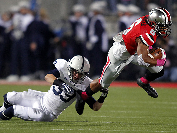 Penn State safety Jesse Della Valle tries to bring down Ohio State wide receiver Evan Spencer. (Paul Vernon/AP)
