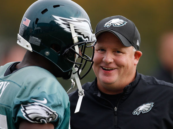 Chip Kelly (right) talks with LeSean McCoy during Eagles practice at the NovaCare Complex. (David Maialetti/Staff Photographer)