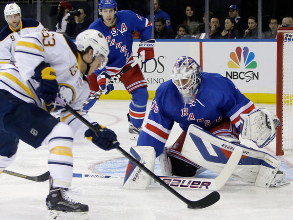 Rangers goalie Henrik Lundqvist, right, of Sweden, defends the goal from Buffalo Sabres´ Tyler Ennis (63) during the first period of an NHL hockey game Thursday, Oct. 31, 2013, in New York. (Frank Franklin II/AP)