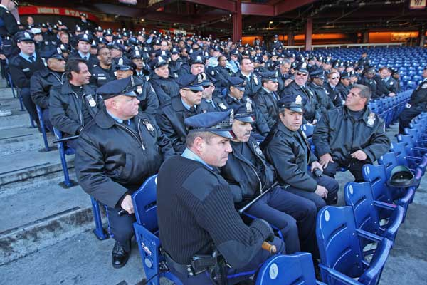 The contingent of Philadelphia Police assigned to cover the Citizens Bank Park rally await their assignements (Michael Bryant/Staff Photographer )