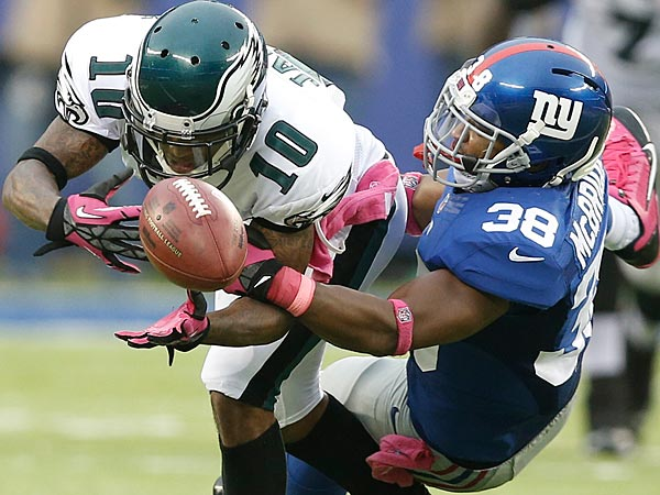 The Eagles´ DeSean Jackson attempts to catch a pass as the Giants´ Trumaine McBride defends him during the second half. (Kathy Willens/AP)