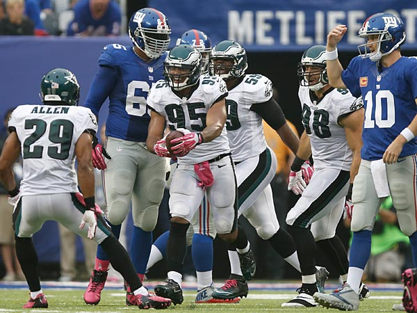 Philadelphia Eagles&acute; Mychal Kendricks (95) celebrates with teammates<br />after intercepting a pass from New York Giants quarterback Eli Manning<br />(10) during the second half. (AP Photo/Kathy Willens)
