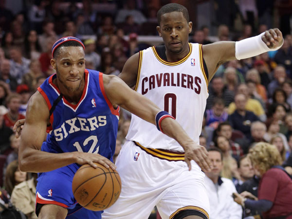 Evan Turner (12) drives past Cleveland Cavaliers´ C.J. Miles (0) during the first quarter of an NBA basketball game Saturday, Nov. 9, 2013, in Cleveland. (Tony Dejak/AP)