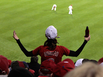 A fan gestures toward the field during the Phillies´ Game 3 loss in the World Series.   (Elizabeth Robertson / Staff Photographer)