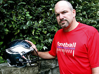 Kevin Turner at his home in Birmingham, Ala. with his Eagles helmet, full of gashes from hits taken as a player. (Butch Dill / For the Daily News)