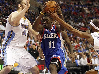 Sixers point guard Jrue Holiday goes up for a basket against the Denver Nuggets. (Yong Kim/Staff Photographer)