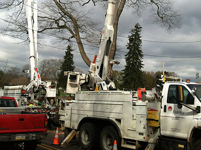 """Crews from New Orleans work on power lines in Solebury Township, Bucks County, on Thursday. """"It took us four days to get here because we had to drive around the storm,"""" one worker, Christian, said. (Bill Reed/Staff)"""