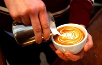 Gray Fisher prepares a cappuccino at Bodhi Coffee. ( David Maialetti / staff photographer )