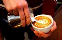 Gray Fisher prepares a cappuccino at Bodhi Coffee. ( David Maialetti / staff photographer )