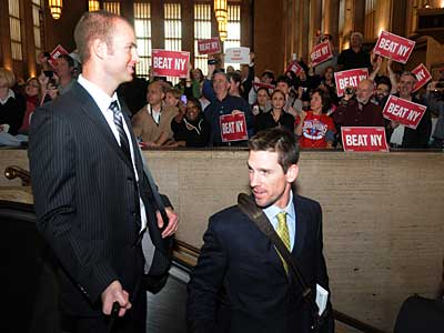 J.A. Happ (left) and Cliff Lee travel down the escalator at 30th Street Station to board a train to New York for Game 6 of the World Series. (Sarah J. Glover/Staff Photographer)