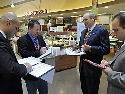 Acme Markets´ president Dan Sanders (2nd from RIGHT) is holding court in the Acme Super Market in the Concord Town Center in Concordville with his management team of (from left) Ajay Kanwar, VP of Merchandising; Tom Miller, Senior VP of Operations, and Don Croce, VP of Sales (right).  They were conducting a standard store tour.   ( Clem Murray / Staff Photographer )