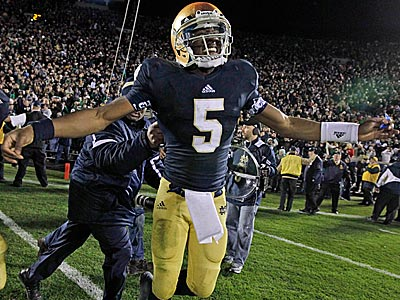 Notre Dame quarterback Everett Golson celebrated after scoring the winning touchdown against Pittsburgh. (Michael Conroy/AP)
